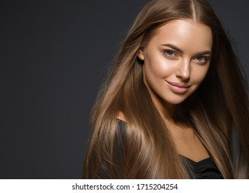 Smooth hair beauty woman smile face natural make up female healthy skin and hair glamour beauty over dark background