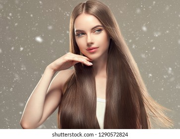 Smooth hair woman winter background snowflakes
