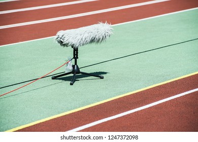Smooth microphone on running track. Athletic stadium. Runn, Racing. Beautiful sunny day.
