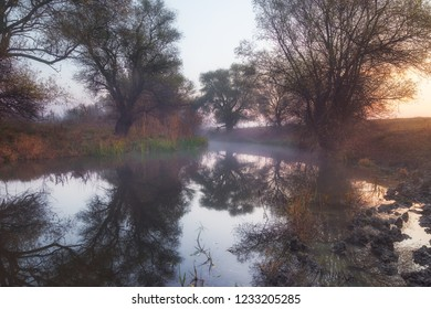 Smooth mist layer above river at sunrise