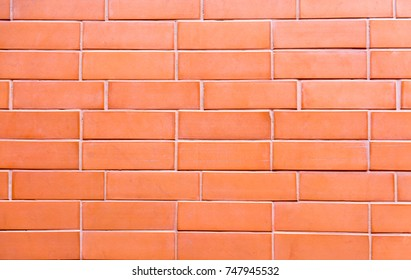 Smooth orange brick wall for texture and background