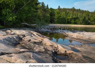 Smooth rocks and a reflecting pool at the Lake Superior shore