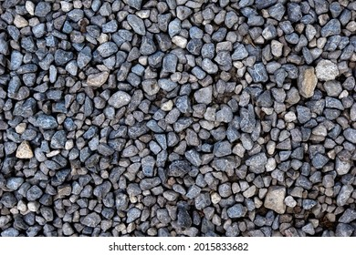 Smooth round pebbles texture background. Pebble sea beach close-up, dark wet pebble and gray dry pebble. High quality photo