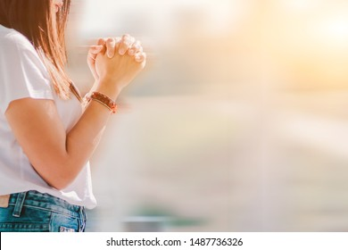Smooth and Soft focus,A young girl prayed for God's blessings with the power and holiness of God On the background blurring the sunlight up in the morning.The concept of God and spirituality.
