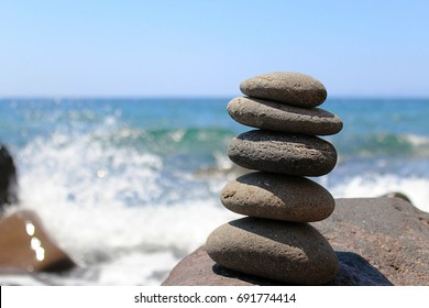 Smooth Stones Stacked on Greek Island Beach