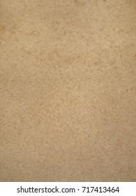 Smooth tan mottled cardboard background