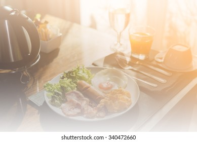 Smooth and warm breakfast set on the table background