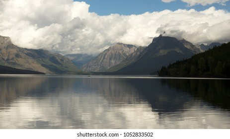 Smooth water in Lake McDonald great for a couple to enjoy a small boat outing