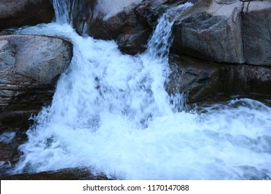 smooth water over waterfalls in nh white mountains