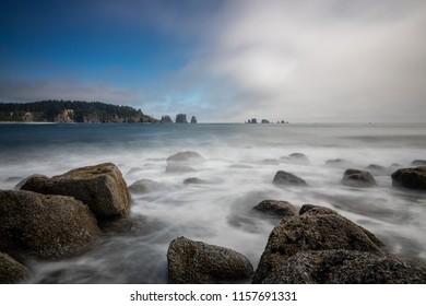 Smooth waves crashing on a rocky beach.
