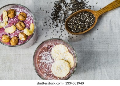 Smoothie bowl breakfast, shot from above. Healthy organic raw food meals in natural rustic background