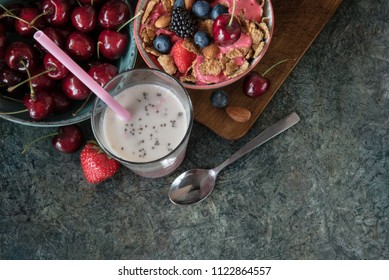 Smoothie bowl with fresh berries, nuts, seeds, fruit.  Healthy breakfast and almond milk