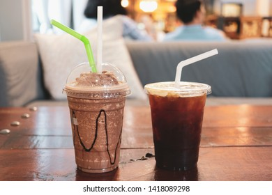 Smoothie coco and americano coffee on wooden table