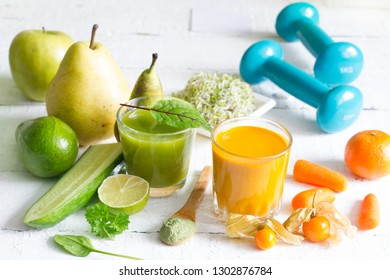 Smoothie fresh fruits dumbell  and young sprouts healthy life style food fitness concept