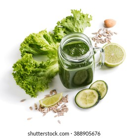 Smoothie of green vegetables ( leafy kale and  cucumber) with lime and seeds of sunflower isolated on white background