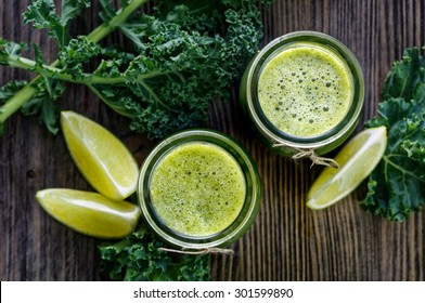 Smoothie of organic kale with the addition of apples and limes