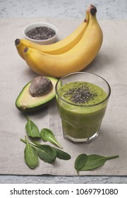 smoothies avocado banana spinach in a glass, bananas and avocado, chia seeds on a linen background