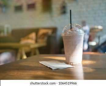 Smoothies in plastic cup on table