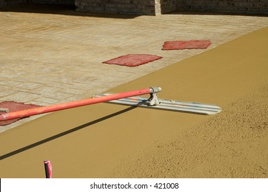 Smoothing new concrete