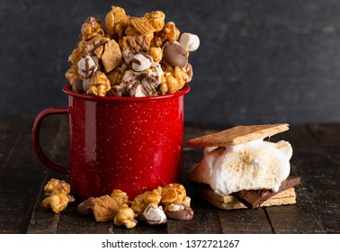 Smore Flavored Popcorn in a Red Camping Mug
