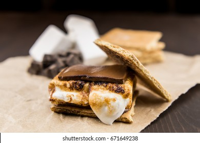 Smore with Graham Cracker Top Leaning of melted chocolate and gooey marshmallow