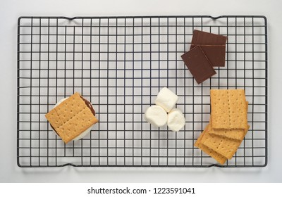 Smores ingredients on a cooling rack flat lay isolated on white