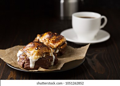 Smores old fashioned fried donut on dark background