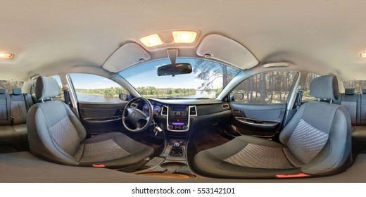 SMORGON, BELARUS - MAY 3, 2014: Full 360 by 180 degrees seamless equirectangular spherical panorama view in interior of prestige modern car geely emgrand cs7 in summer forest. 360 angle panorama view