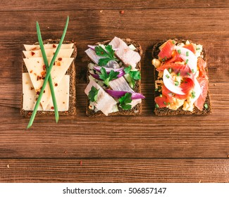 Smorrebrod - danish open sandwich with fish, herring, cheese