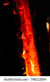 a smouldering burning wood log fire-pit