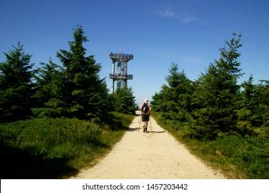 Smrk, Isera Mountains, czech republic, July 2019, unidentified tourist walk towards the famous lookout tower on the mountain Smrk in the Isera Mountains in the czech Republic in summer 2019 - Shutterstock ID 1457203442