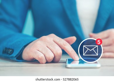 SMS business communication, businesswoman using smartphone in the office