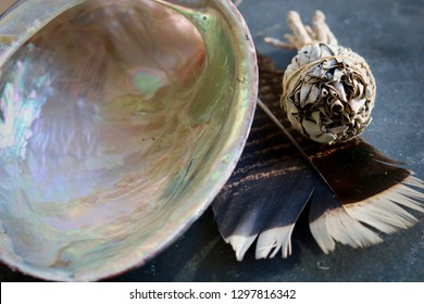 A smudge kit. Turkey feather, abalone shell and a small white sage smudge stick. Cleansing and warding away negative energy. Ceremonial