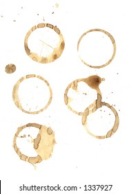 Smudged coffee rings and spills on a pure white piece of paper. A rushed morning tea break mess.