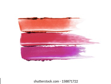 Smudged lipstick isolated on white