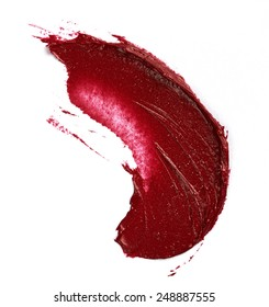 Smudged lipstick isolated on white background
