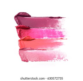 Smudged lipsticks isolated on white