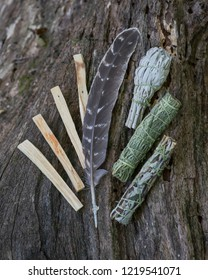 Smudging kit - Grade A barred turkey smudging feather, Peruvian  Palo Santo holy wood sticks, Wildcrafted dried White Sage, Mugwort, and Siskiyou Cedar wrapped in organic hemp twine on wood bark.
