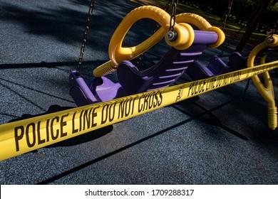 Smyrna, GA / USA - Apr 13, 2020:  COVID-19 Police tape blocks access to playground in purple and yellow.
