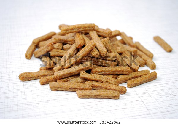 Snack to beer. Croutons are scattered on a table