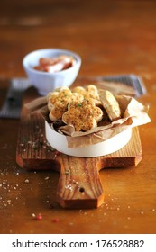 Snack cheese cookies or scones with bacon, parmesan and basil in a box, perfect for breakfast or summer picnic