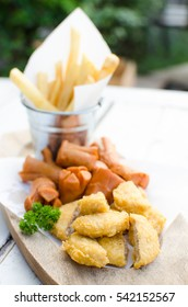 snack combo serve with french fries sausage and fried nuggets