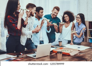 Snack. Have Lunch. Eat Pizza Together. Designers. Different Nationalities. Work. Table. Young Employees. Sandwiches. Large Bright Office. Group. Young. Color Samples. Design. Project. Teamwork.