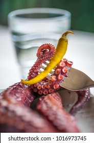 A snack made of octapus tentacle and a green spicy pepper octapus tentacles selective focus selective focus
