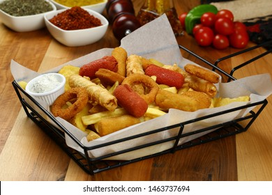 Snack platter - French fries, spring rolls, fried sausage, chicken nugget, Turkish pastry, onion rings, potato croquette