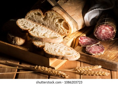 snack with rustic bread and salami on the wooden table
