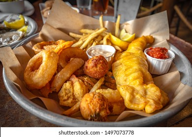 Snack Sampler, French fries,Fried onion,Cheese bite and Fried chicken tender with ketchup and homemade dipping sauce.