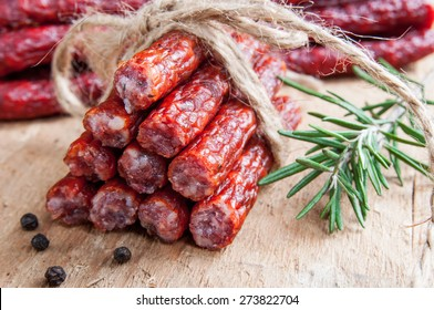 Snack stick sausage on rustic wood