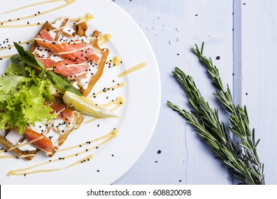 snack of waffle with cheese and salmon