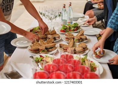 Snacks, fish and meat specialities on the buffet. white table